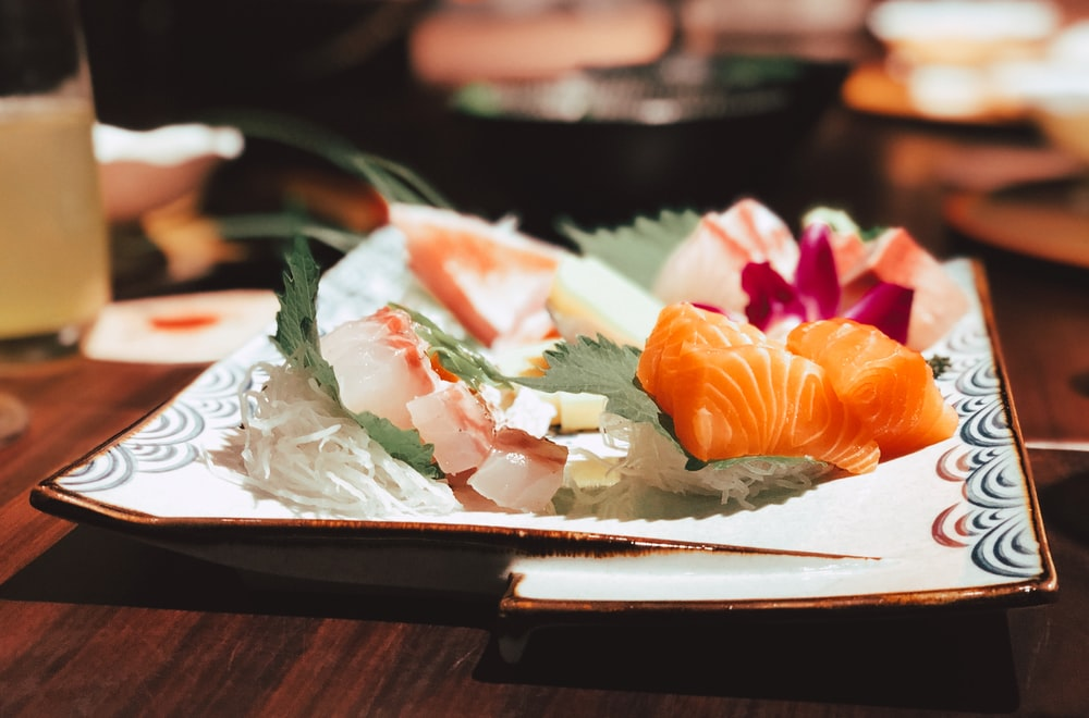 plate of sushi on wooden table