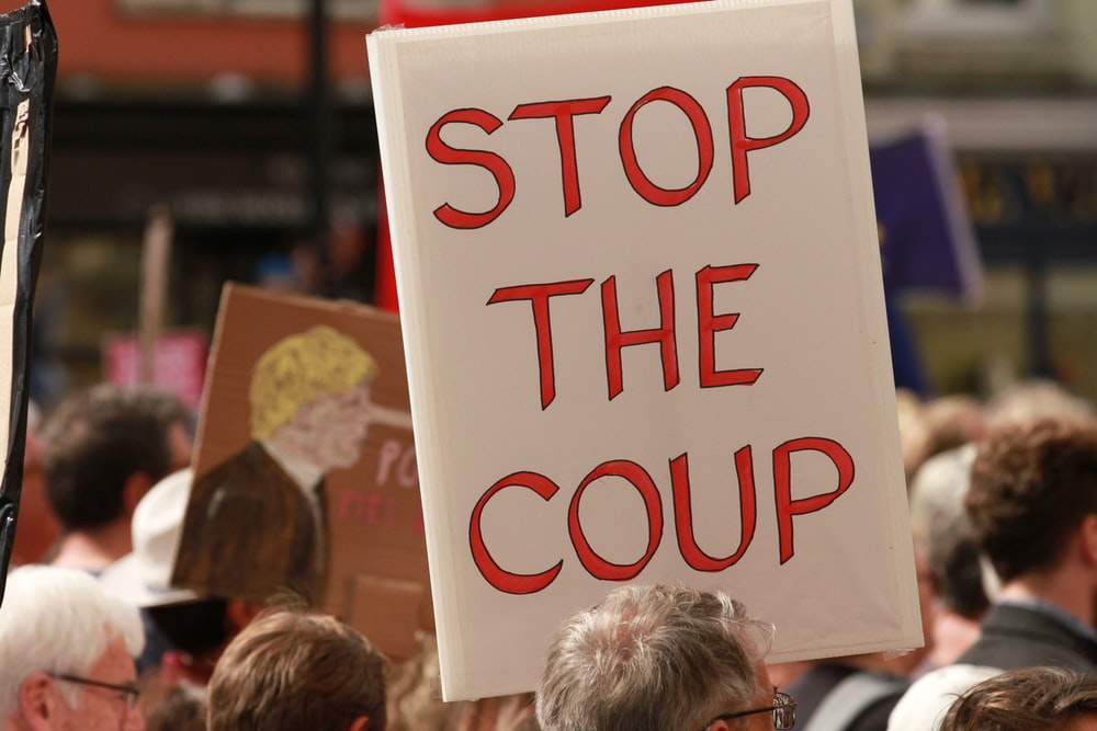 stop the coup signage
