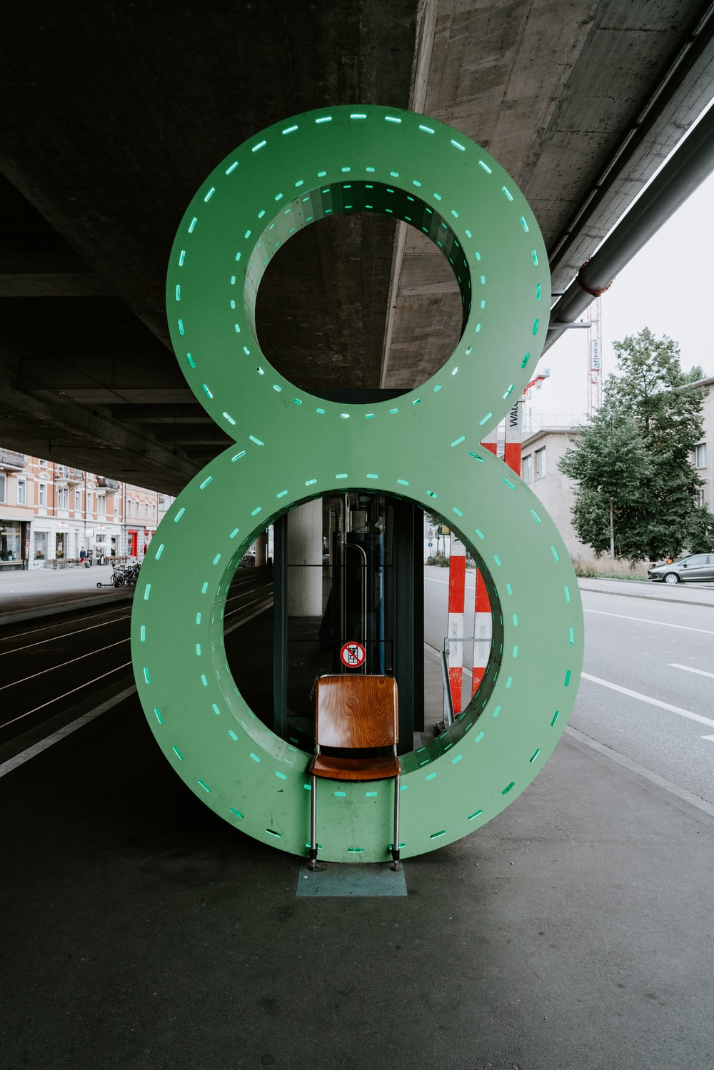 empty chair in front of green number 8 sign