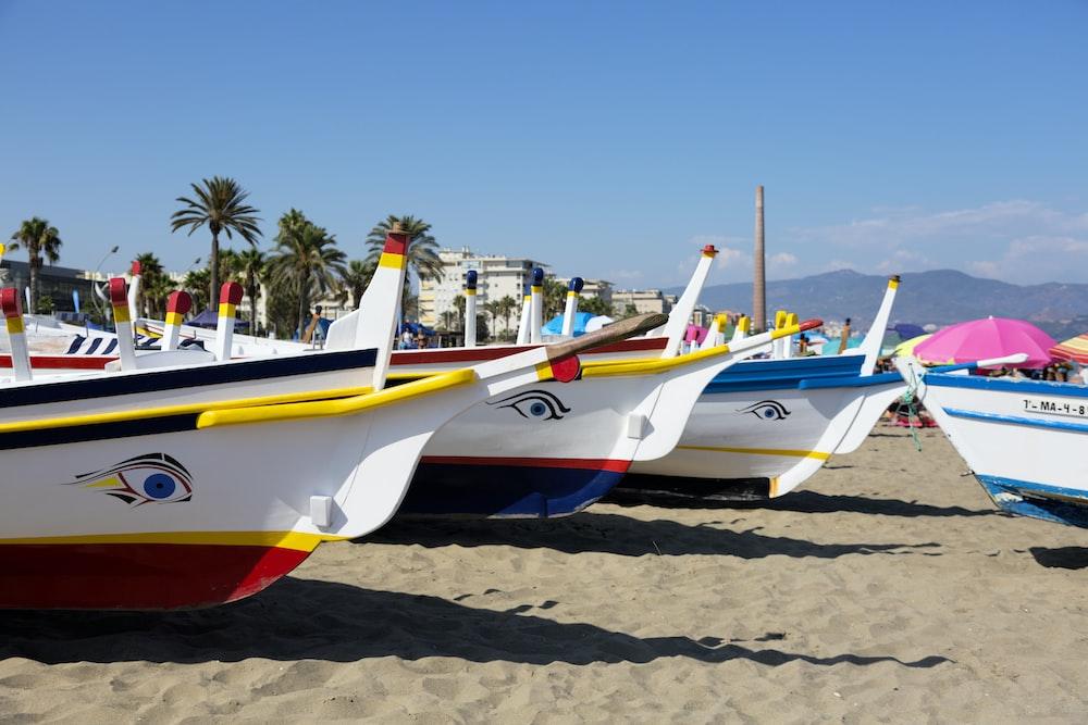 lined boats on seashore
