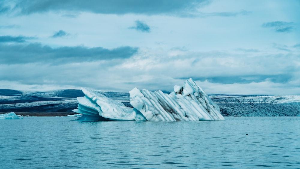 icebergs on body of water