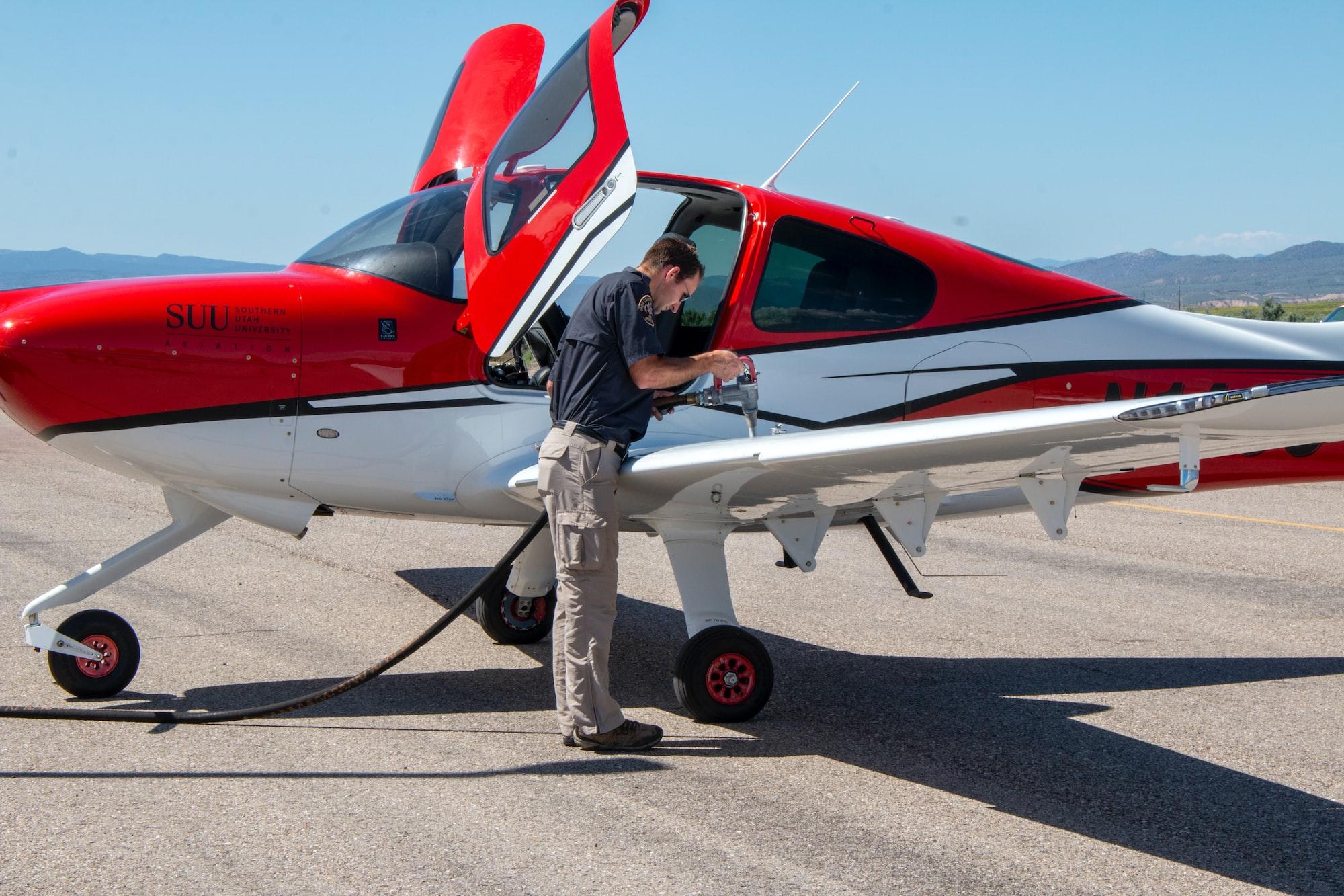 Pilot filling up an SUU Aviation fixed-wing aircraft