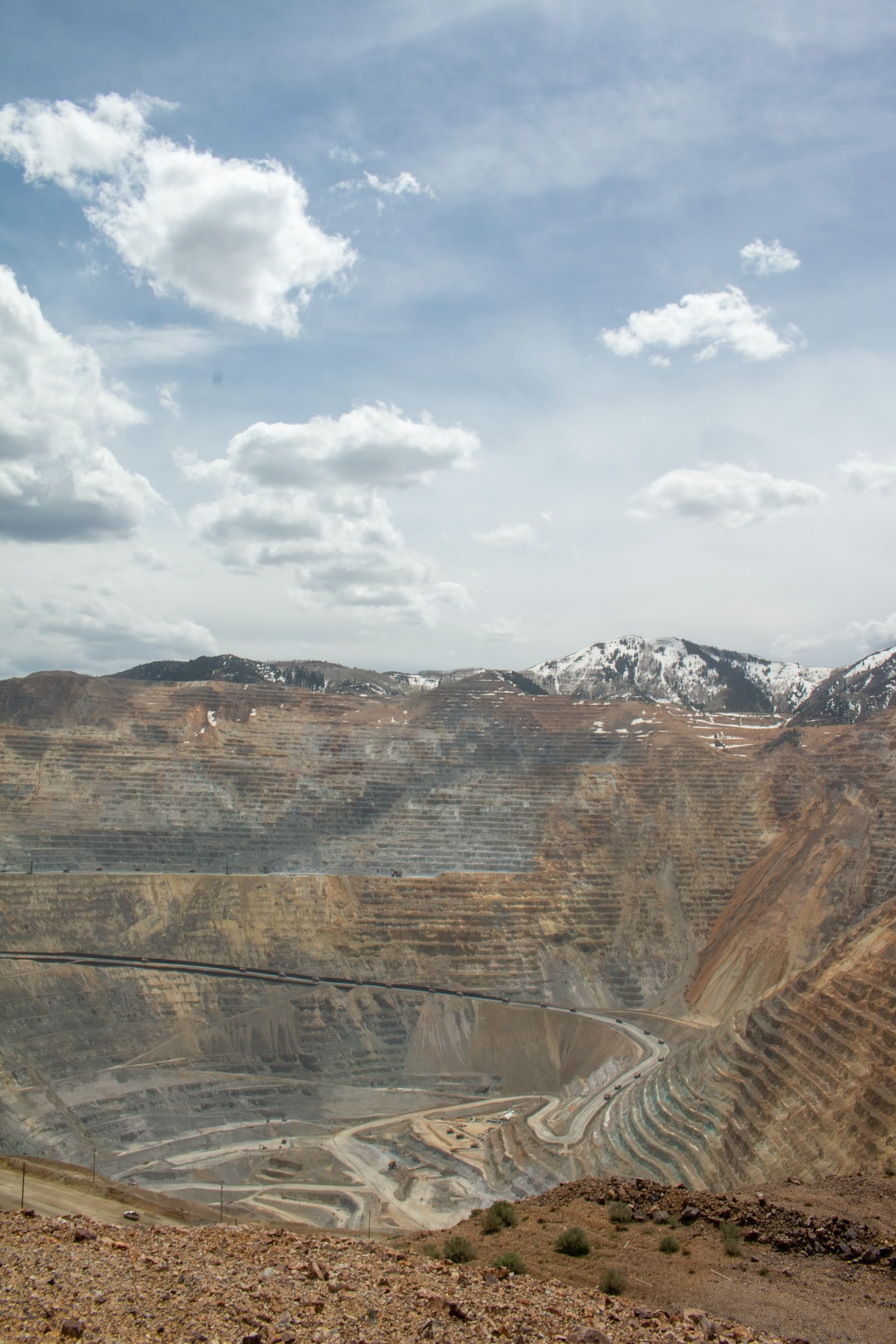View of the Bingham Canyon Mine. Each of the vehicles driving down is two stories tall.