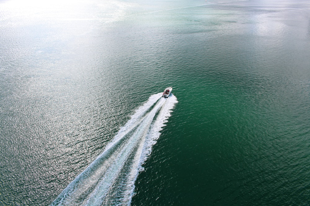 speedboat on body of water