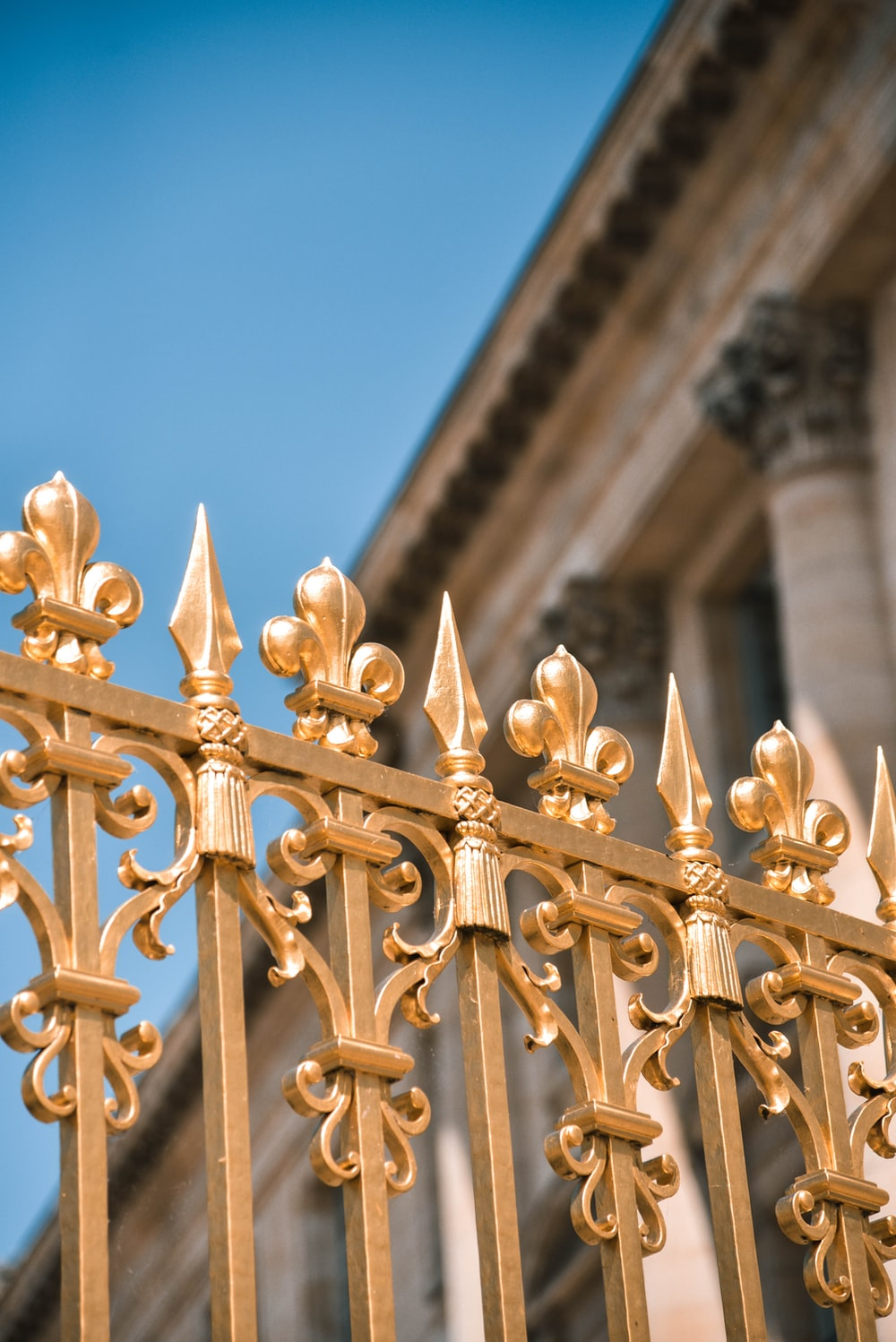 brass-colored fence
