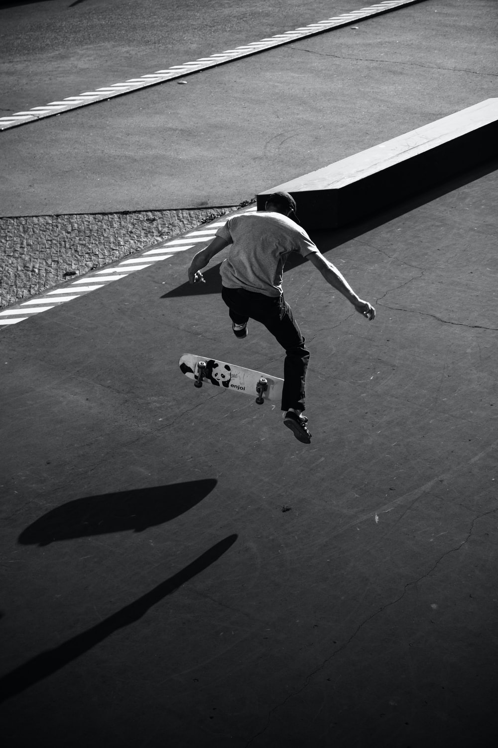 grayscale photography of man skateboarding