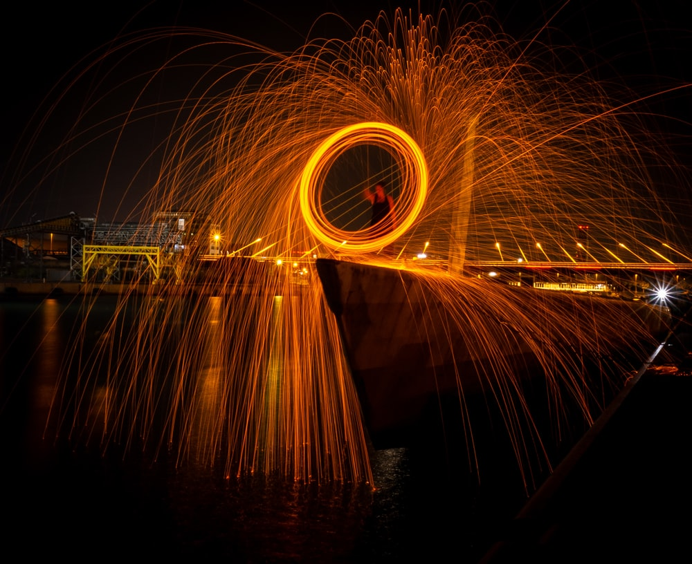 long-exposure photography of fire dance show