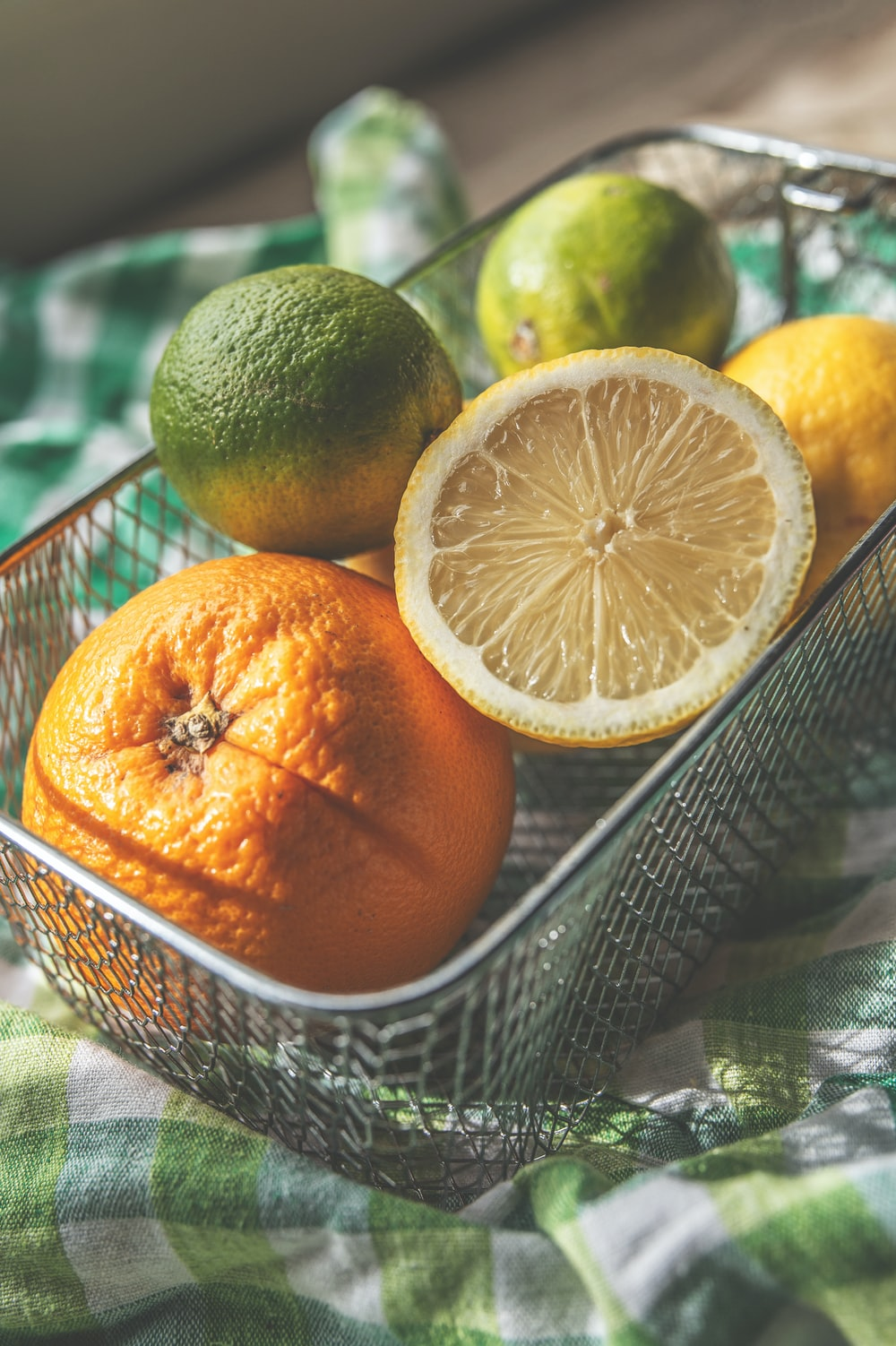 lemons and oranges in basket