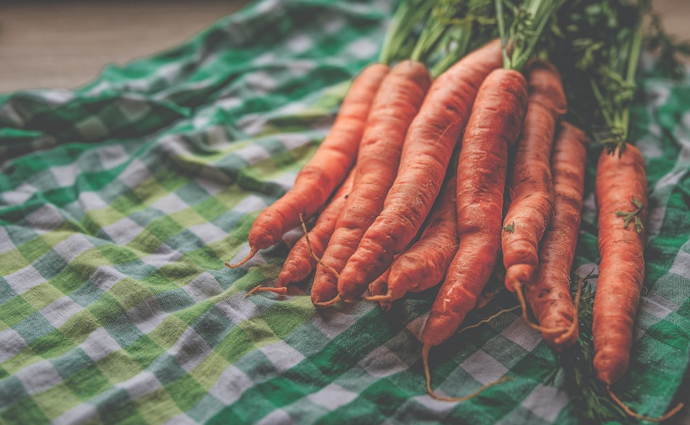 carrots on green and white plaid cloth