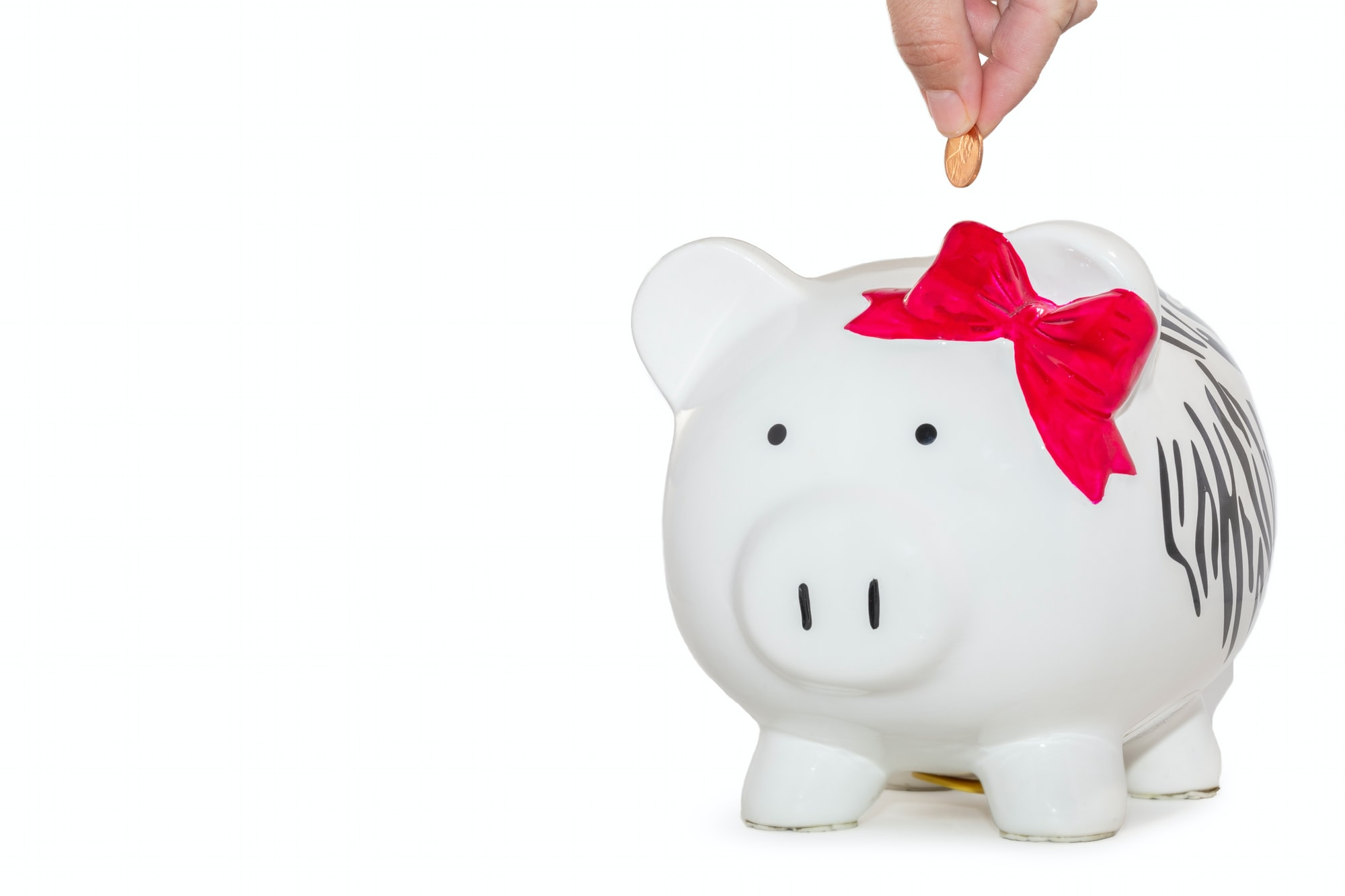 Saving money with a piggy bank