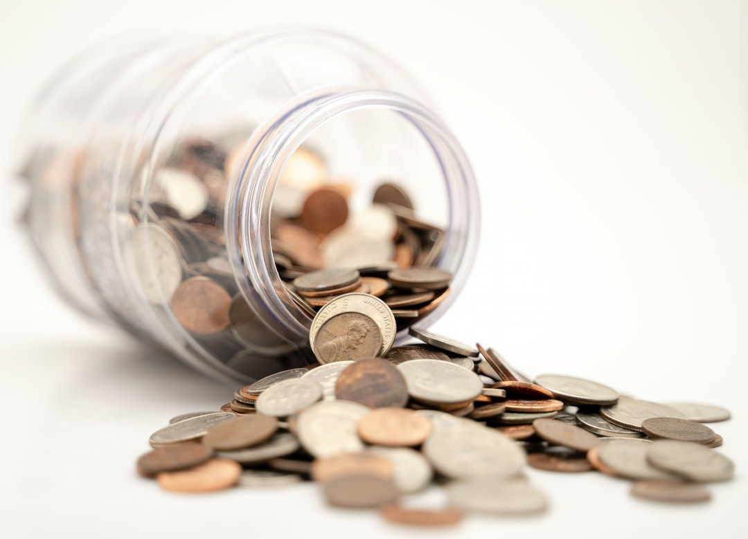 Coins spilling out of jar