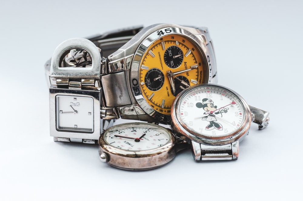 three silver-colored watches
