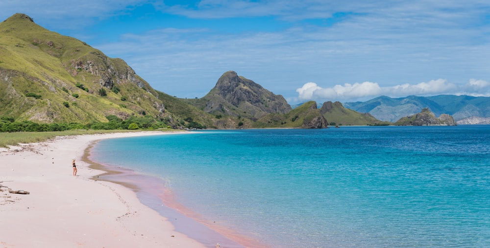 beach besides green hills