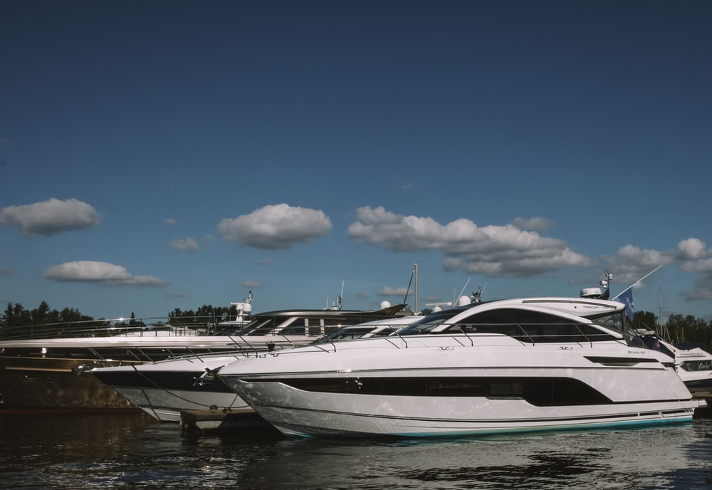 cabin cruiser boats floating on body of water during day
