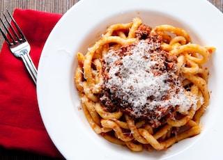pici pasta with lamb ragu and parmesan cheese