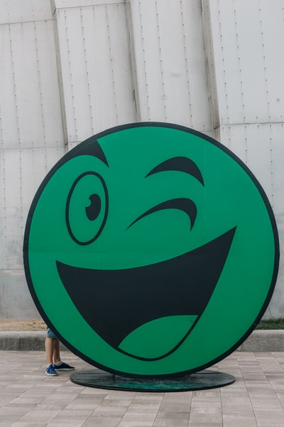 green emoji standee