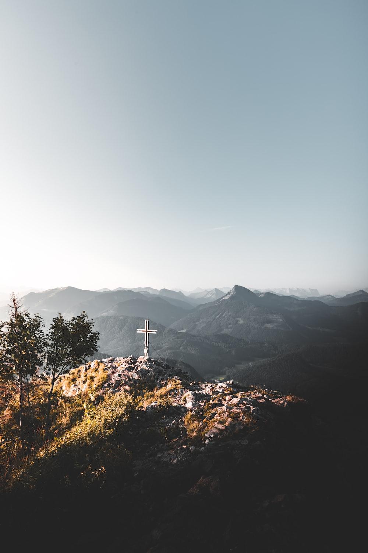 cross on gray rock