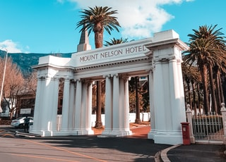 Mount Nelson Hotel arch under cloudy sky