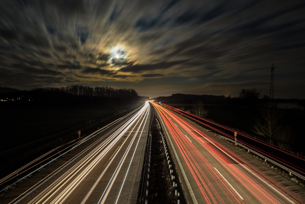 long exposure photography of vehicles at night time