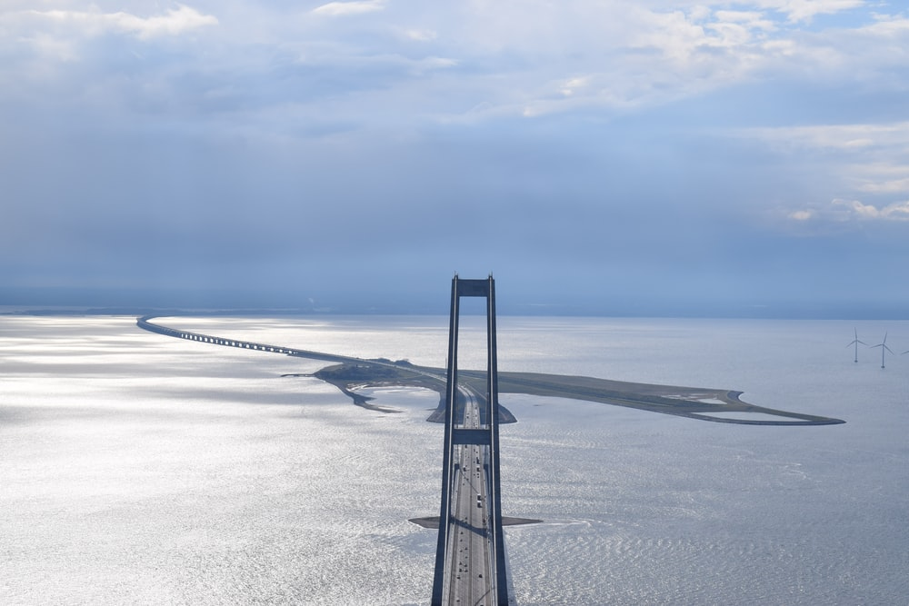 photo of gray and maroon bridge aerial view
