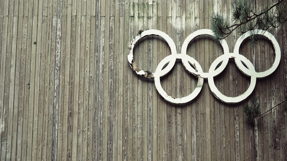 Olympic symbols on wooden wall