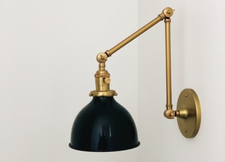 black and gold sconce