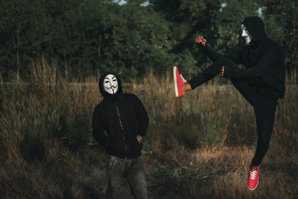 men wearing guy fawke masks