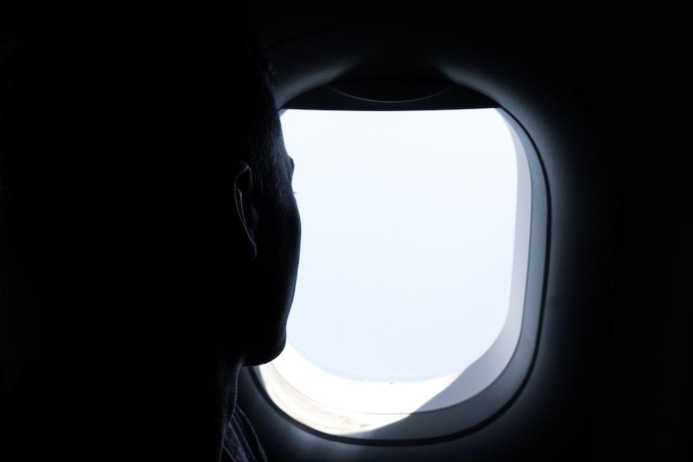 man beside window