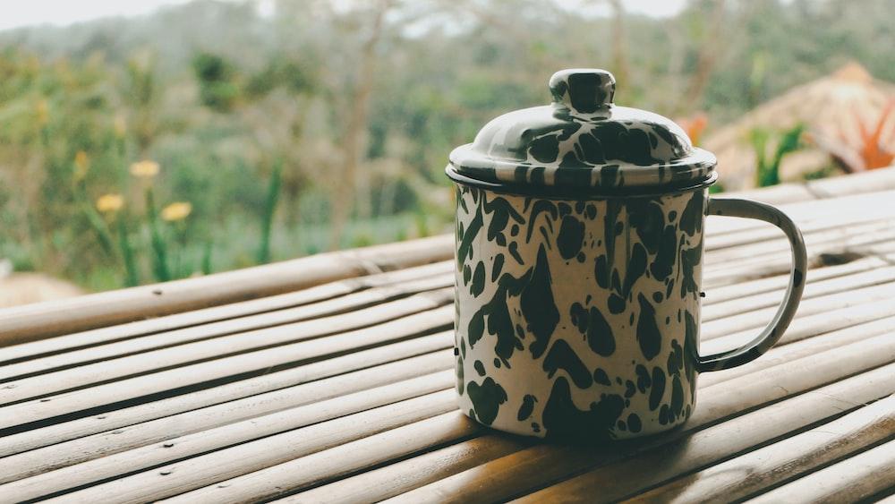 black and white mug with lid
