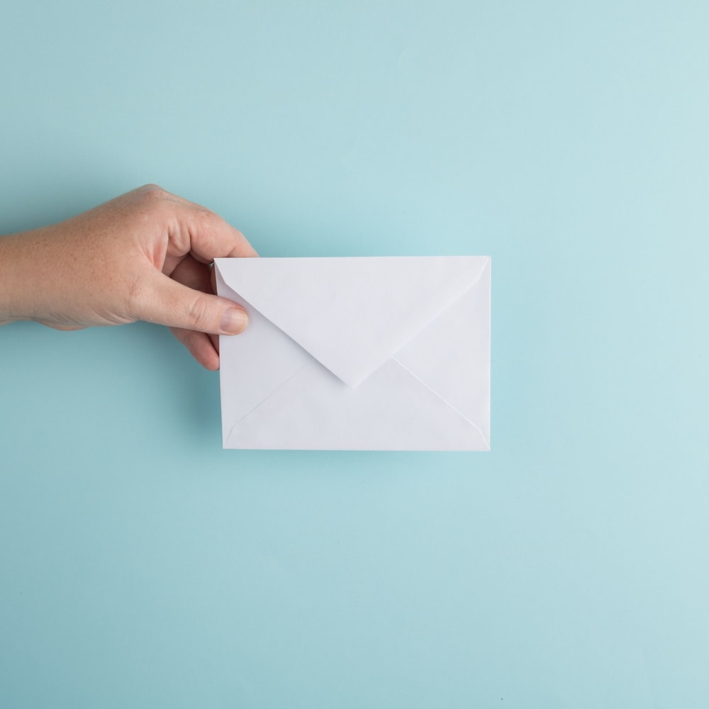 person showing white envelope