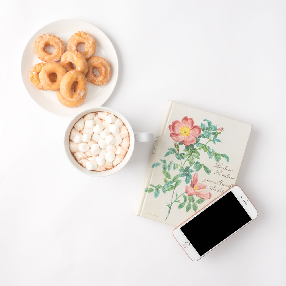 flat lay photography of food and book