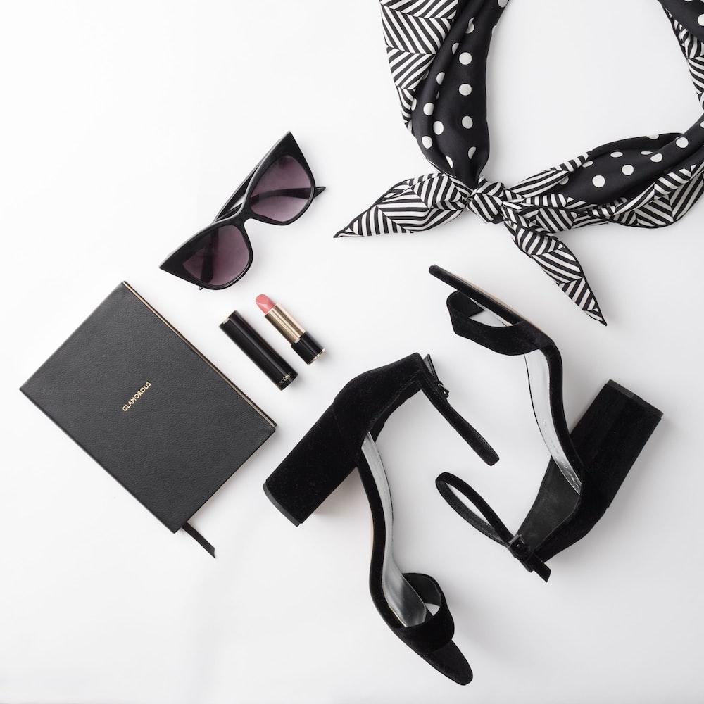 lipstick beside sunglasses and sandals