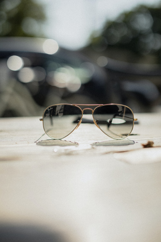gold-framed Aviator-style sunglasses