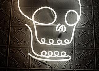 human skull neon light signage