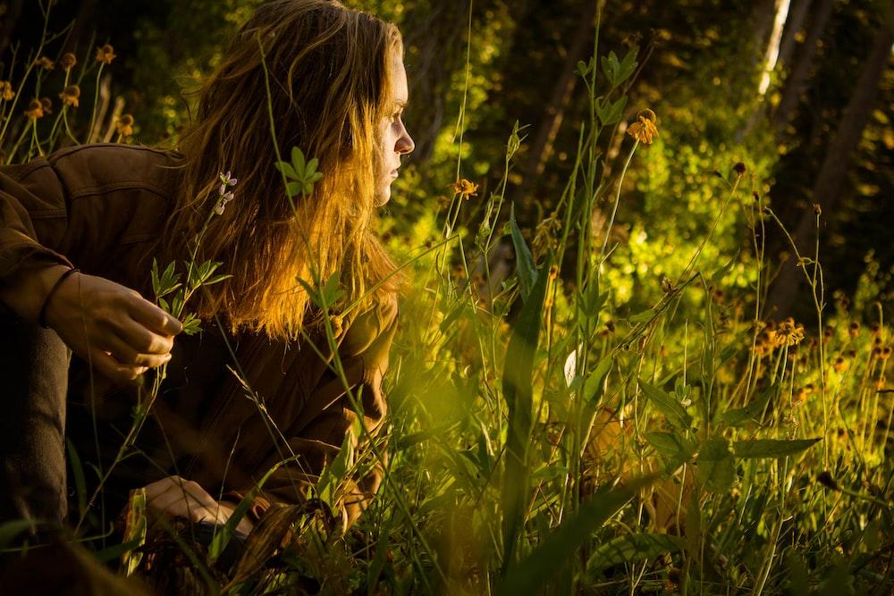 man sitting in grass field