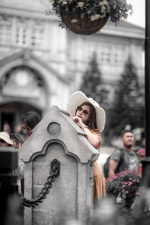 photo of woman wearing beige dress