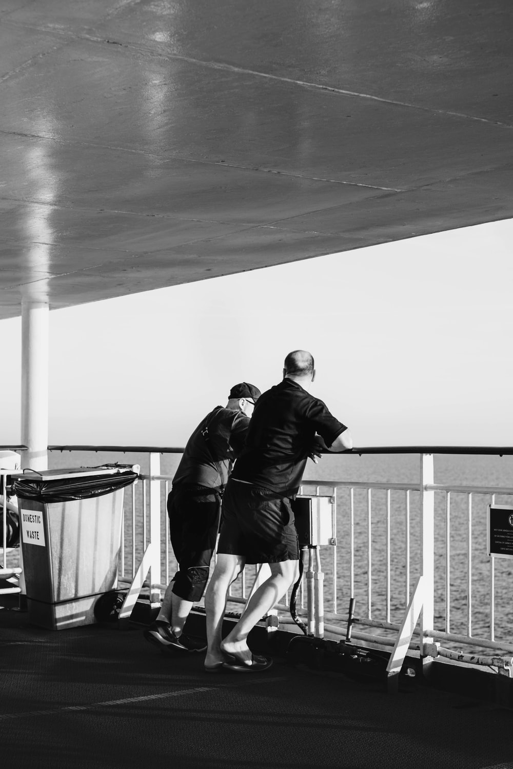two men standing on boat