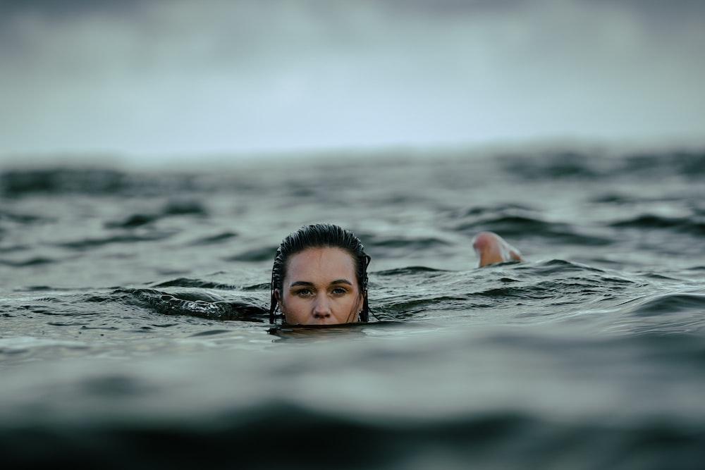 woman dipping in ocean