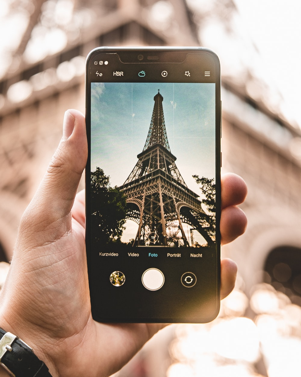 smartphone with Eiffel Tower during daytime photo