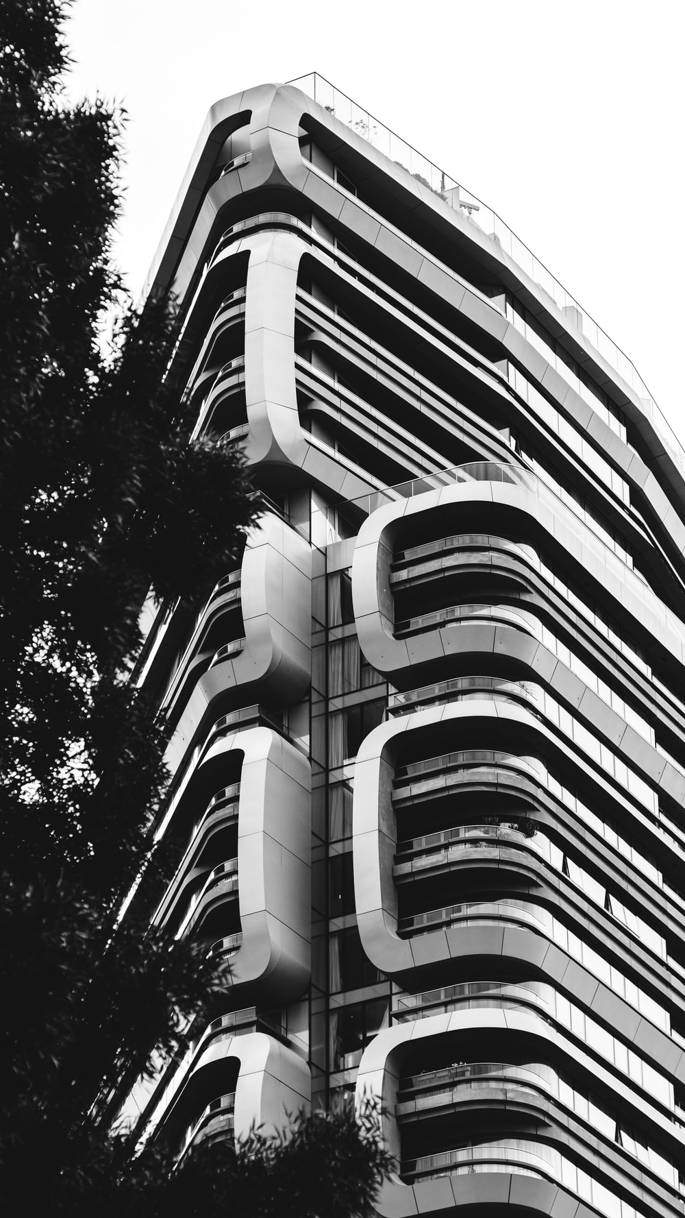 grayscale and low angle photography of concrete building
