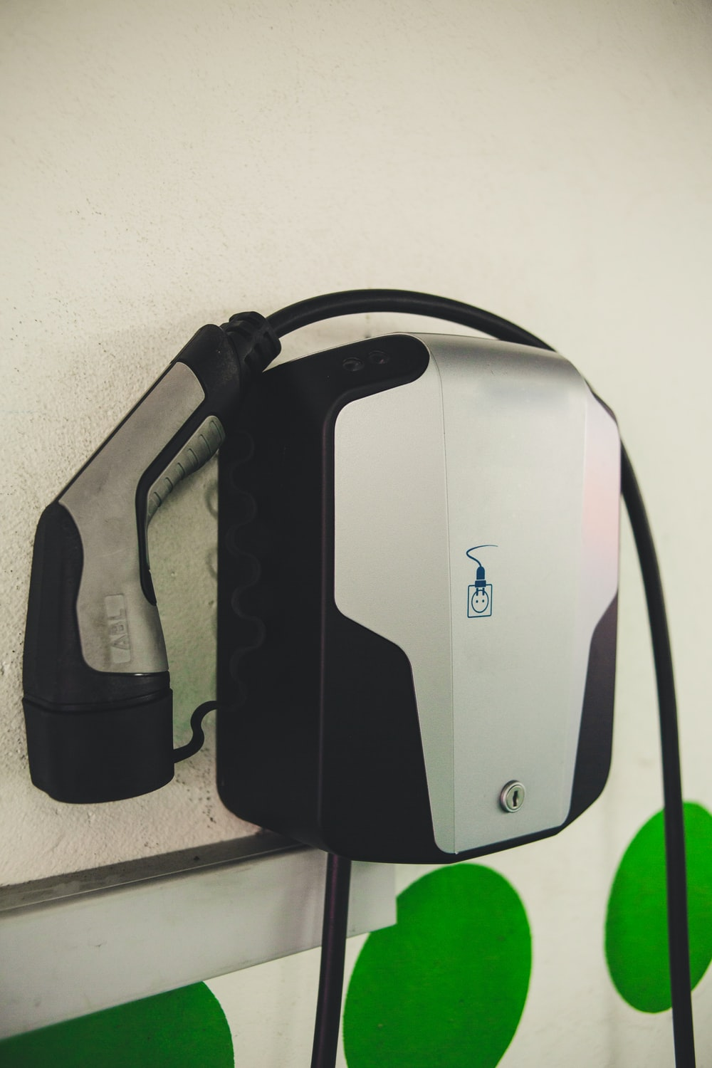 square black and white corded device