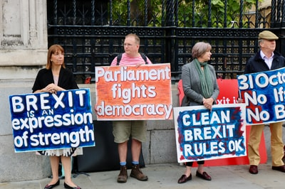 four person holding sign boards