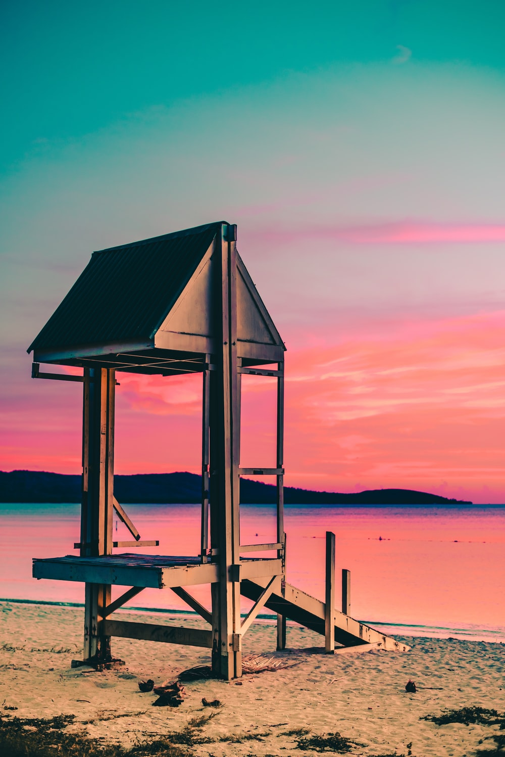 lifeguard house by the seashore during golden hour