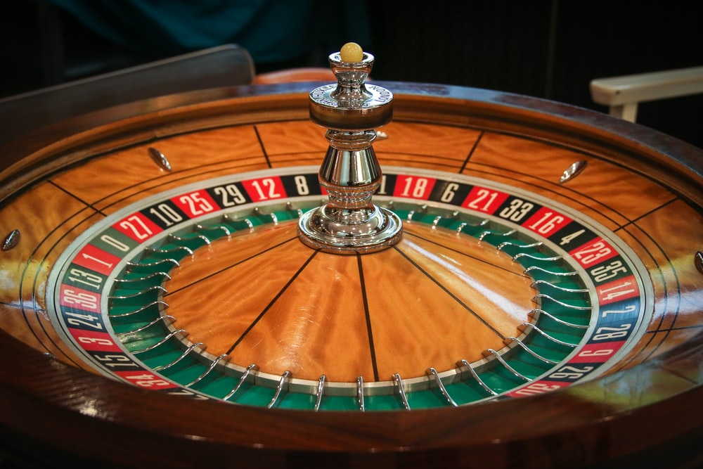 brown, green, and red casino roulette