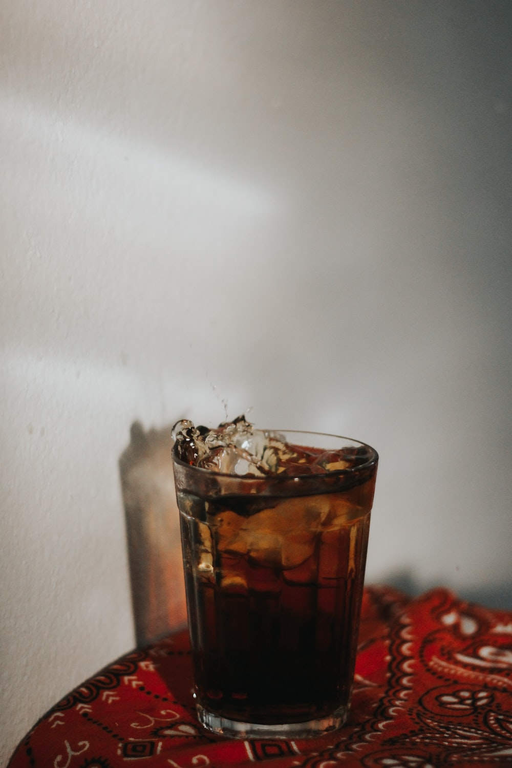 glass of carbonated drink on red bandana