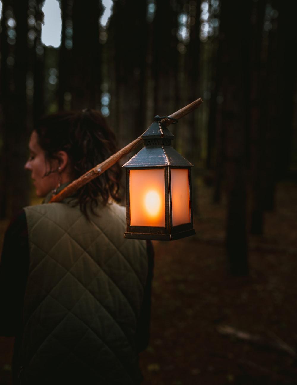 woman holding candle lantern