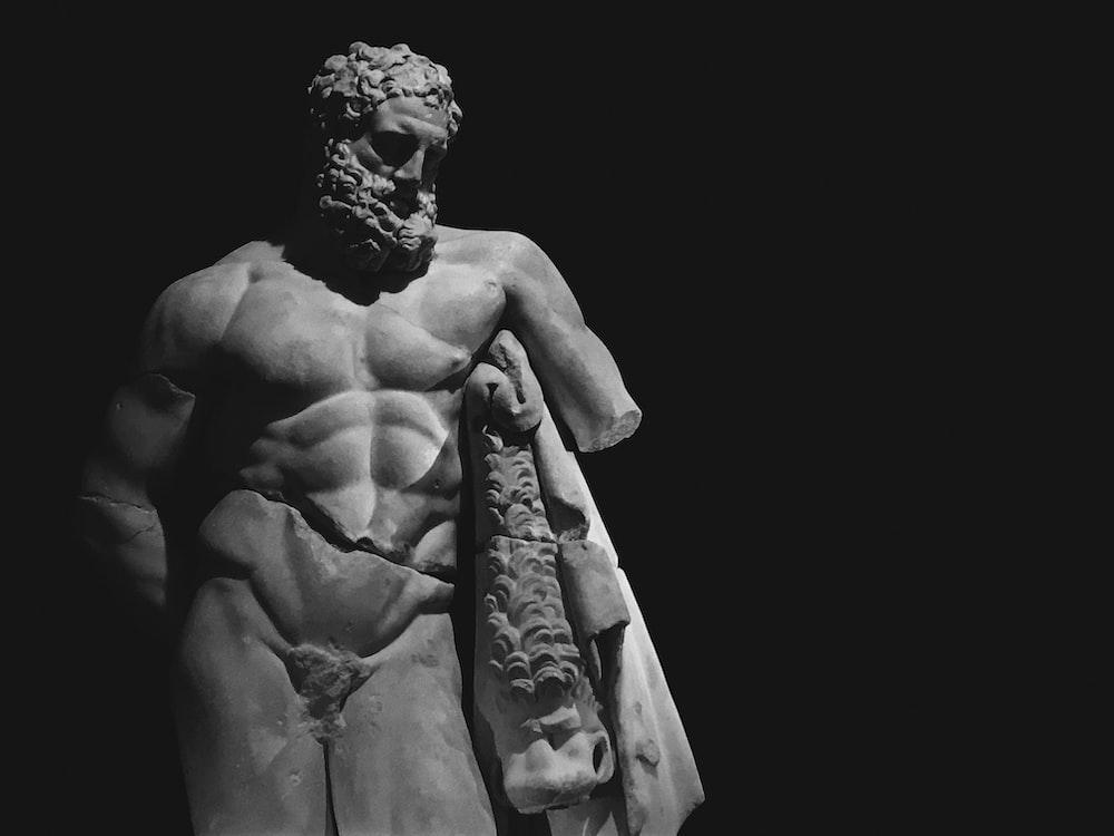naked man concrete statue