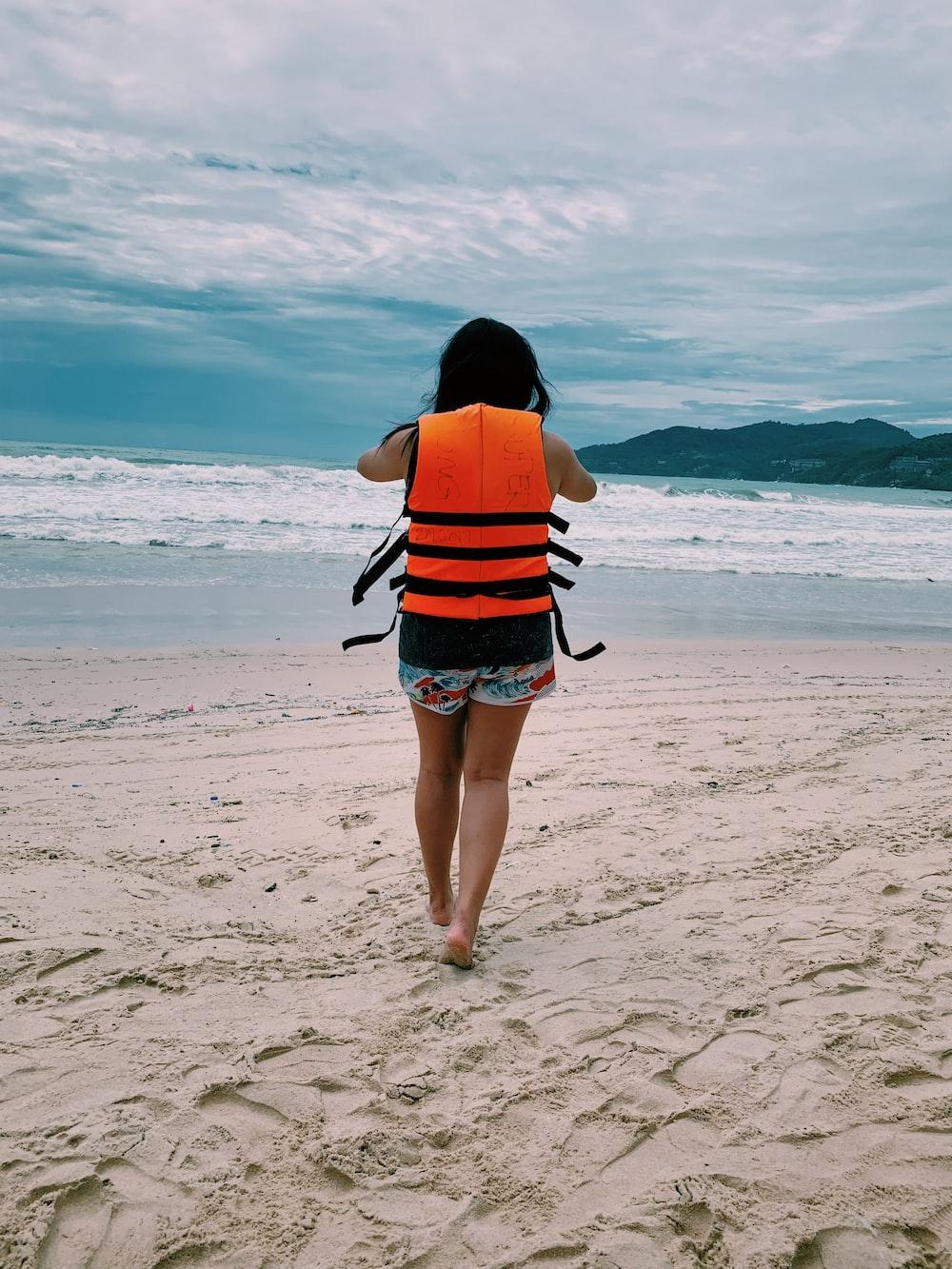 woman walking towards beach