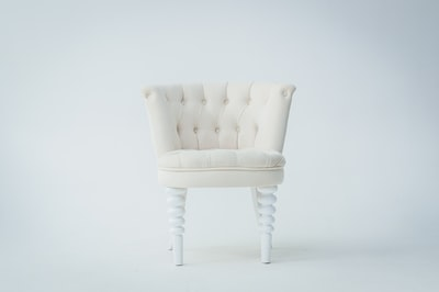 tufted beige sofa chair chair zoom background