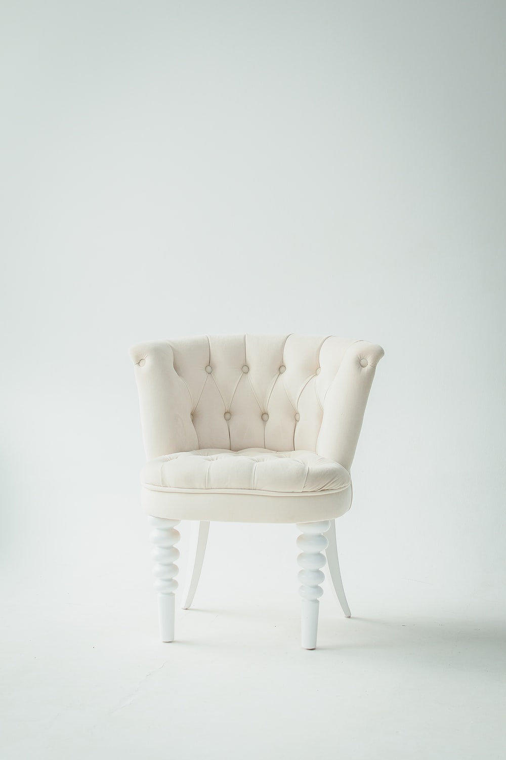 tufted white leather sofa chair